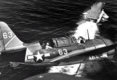 """Curtiss SB2C Helldiver landing on an aircraft carrier """"Yorktown""""  http://albumwar2.com/curtiss-sb2c-helldiver-landing-on-an-aircraft-carrier-yorktown/"""