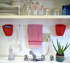 small kitchen ideas tension rod above the sinks and open shelving, kitchen design, organizing, shelving ideas, urban living Custom Storage, Kitchen Storage Space, Organizing Your Home, Sink Shelf, Small Kitchen, Storage Spaces, Tension Rod, Small Kitchen Storage, Kitchen Storage