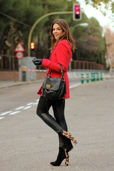 Add some fun to black with a red over coat and animal print heels!