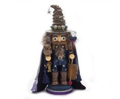 "A fun twist on an old classic! - 15"" tall. - Wood, resin, fabric. - Kurt Adler Hollywood Nutcracker Collection. - Imported."