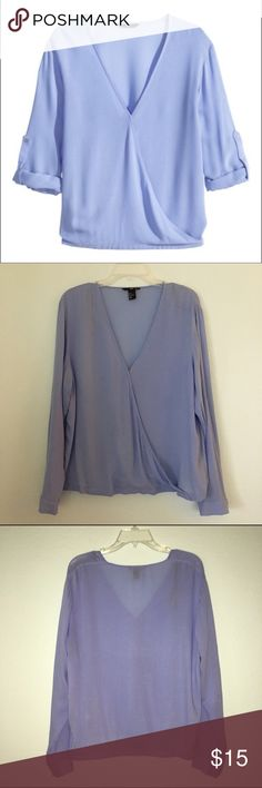 Blue Wrap Front Blouse Blue wrap front top with button to ensure modesty. Button tabs inside for a rolled sleeve look. Very professional and stylish. Only worn once H&M Tops Blouses