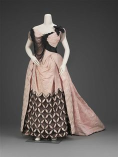 1893, France - Evening dress by Charles Frederick Worth - Silk plain weave patterned with weft floats, trimmed with silk plain weave [chiffon], satin ribbons, jet beads, and machine net