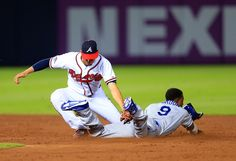 CrowdCam Hot Shot: Atlanta Braves shortstop Andrelton Simmons tags out Los Angeles Dodgers shortstop Dee Gordon on a stolen base attempt in the ninth inning of game two of the National League divisional series playoff baseball game at Turner Field. Photo by Daniel Shirey