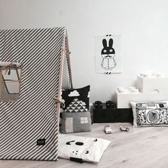 Black & White. That camera pillow would be my husband's dream ;)