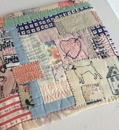 """A hand stitched patchwork with printed detail and scraps of a vintage American quilt finished with a hand stitch sacred heartEmbroidery Measures: 19cm/19cmThis items is mounted on a rough natural board measuring: 25/25cmThis items will come wrapped and posted recorded delivery please note this is a one of item that is why it will be posted requiring a signature on delivery to your addressTO VIEW MORE ITEMS FROM MY """"HOME"""" EXHIBITION GO TO THE PRODUCTS LINK A..."""