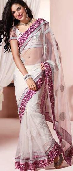 Off White Net Saree with Blouse    Itemcode: SDW1311    Price: US $68.02    Click @ http://www.utsavfashion.com/store/sarees-large.aspx?icode=sdw1311