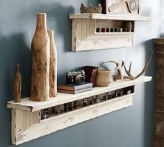 wood shelves with antlers! <3