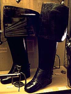 The Officer should wear jackboots with squared toes of spur leather and metal spurs with star rowels. These boots should be buckle tops (Cassin - Scott 56).    - The riding boots pictured to the left are not just fashionable but practical as well.