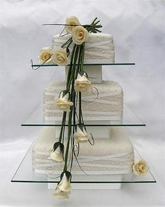 long stemmed ivory roses and glass sheets wedding cake from sugarlicious ltd