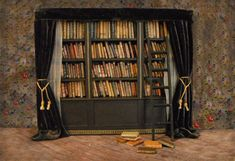Miniature bookshelf with more than 250 individually crafted miniature books by L Delaney