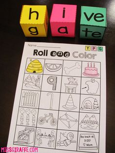 Long vowels activities where kids roll the dice to build CVCe words and color on their game board! I love this game for literacy centers and small group reading!