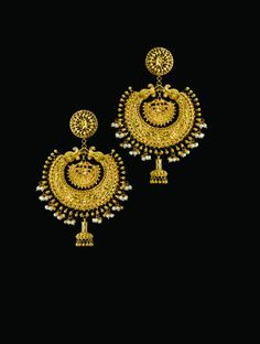 'The Naksha Kanbala'  In the halcyon days of the Bengali Zamindars, these elegant guinea gold Kanbalas would have been de rigueur for the ladies of the house. Today, however, they've become a precious rarity.  Made by a line of all but extinct master artisans, these immaculately hand-chased, hand-crafted beauties give an altogether different spin to the word 'earrings' and are guaranteed 'show-stoppers' everywhere.