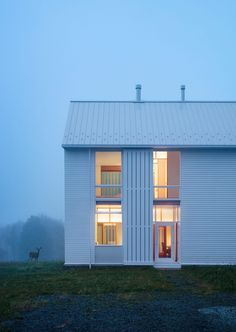 Modern minimalist farmhouse White exterior siding with movable screens A farmhouse in PA by Cutler Anderson Architects Architecture Résidentielle, Minimalist Architecture, Farmhouse Architecture, Transitional Living Rooms, Transitional House, Transitional Lighting, Journal Du Design, Good House, Home Projects