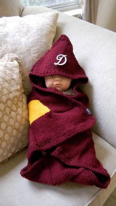 Mrs. Weasley's Knitted Harry Potter Baby Blanket.  (Trying to ignore the fake baby)