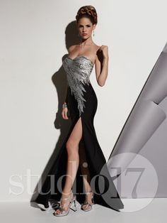 Studio 17 Style 12436: Strapless sweetheart neckline, fully sequined bodice in multi-color flames, trumpet skirt in black jersey. #prom #prom2014 #pageant #dress #specialoccasion #formalwear #studio17 #houseofwu