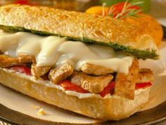 Italian Pork Melts - Strips of pork covered with pepper pieces and cheese, then melted until bubbly. Yum!