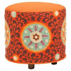 "Multicolor ottoman with medallion-print cotton upholstery and exposed legs.    Product: OttomanConstruction Material: Cotton fabric and wood baseColor: Rust and orangeDimensions: 21"" H x 21"" DiameterCleaning and Care: Dry clean"