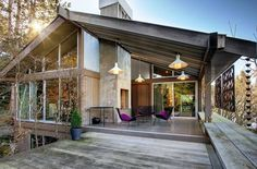 Midcentury Seattle house with an extended patio and walk-out lower level. Wow.