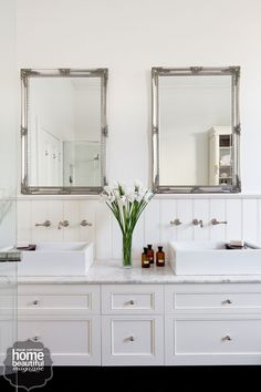 Vintage bathroom sanctuary- elegant retreat, including a pretty Mirabella chandelier, French provincial-style fittings and pale panelled walls.
