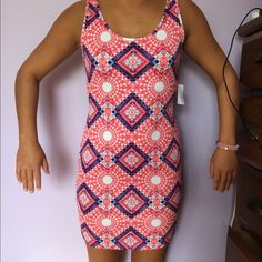 Slim fitting dress from Charlotte Russe Slim fitting patterned dress with bright colors. Partially opened back. Never worn. Charlotte Russe Dresses