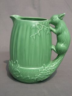 A green glazed Sylvac jug the handle in the form of a squirrel, the base impressed 1959 Sylvac 8""