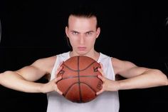 Basketball player portrait on black background image by Albo from Fotolia.com