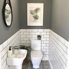 The little room with a wonderfully big tiling solution. bother the metro wall tiles with coloured grout and the patterned floor tiles. Small Downstairs Toilet, Small Toilet Room, Downstairs Cloakroom, Small Toilet Design, Small Toilet Decor, Small Bathroom Ideas, Toilet Room Decor, Cloakroom Ideas, Pictures In Bathroom