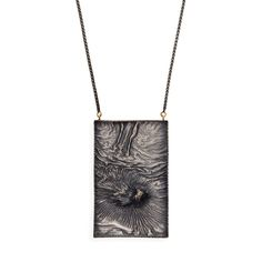 Riveting Reticulation by Harold O'Connor | Oxidized & reticulated sterling silver This pendant features a subtle landscape of extraordinary reticulated silver, created using an extremely hot torch with a pin pointed shaped flame.
