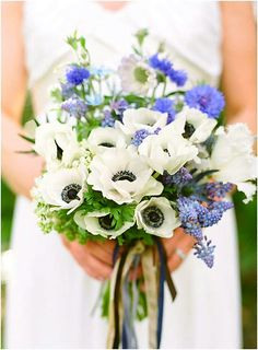 White Anemones, White Fringed Tulips, White Lilac, Lavender Scabiosa, Blue Grape Muscari Hyacinth, Blue Cornflower, Blue Tweedia, Green Foliage Bridal Bouquet