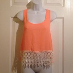 """TOBI Bright Peach Lace, chiffon Top Shirt SMALL TOBI   Bright Peach Lace and chiffon Top   Size SMALL   This is a pretty top in a sheer polyester chiffon. The front is trimmed with a wide base of lace. This top would be cute with a lace bralette under and white or light colored Jean shorts.   Item is pre-owned but is in EXCELLENT condition.       Measurements are taken laying flat. U to U 17.5"""".  Shoulder to Hem 22"""".  Width at bottom hem 19"""" Tobi Tops Blouses"""
