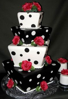 Black and white dotted cake with red roses.  Submitted by Nicole S. & made by Sugar Bakers
