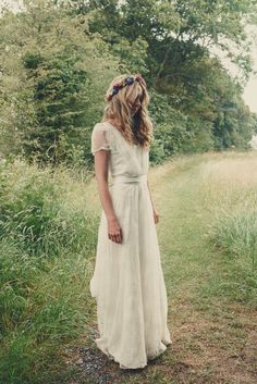 The beautiful boho bride wears a Charlie Brear dress and veil for her woodland festival wedding at Hawthbush Farm in Sussex. Photography by Modern Vintage Weddings, visit modernvinteageweddings.com.