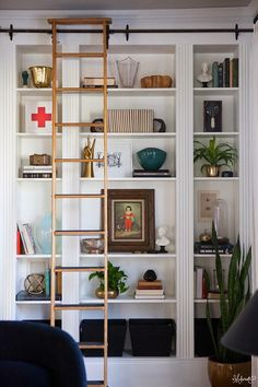 This glam home library (complete with rolling ladder!) was fashioned from three Ikea bookcases. #DIY