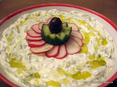 Tzatziki. yogurt, garlic, cucumber, dill, salt, and olive oil.  and throw a little ouzo in there, too!