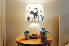 Create a silhouetted scene on an old lampshade to add some Disney magic to your child's bedroom or play room.