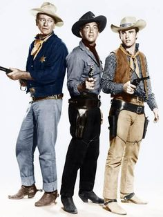 Hand color tinted photo of John Wayne, Dean Martin & Ricky Nelson from the 1959 movie, Rio Bravo Ricky Nelson, Willie Nelson, Dean Martin, John Wayne Quotes, John Wayne Movies, Citations De John Wayne, I Movie, Movie Stars, Movie Theater