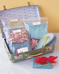 """Vacation Outfit Bags    For easy dressing on a family trip, pack a child's suitcase full of ready-to go getups. Put outfits in separate resealable plastic bags; use stickers to label with day or type of outfit (such as """"for rain"""" or """"for special occasion"""")."""