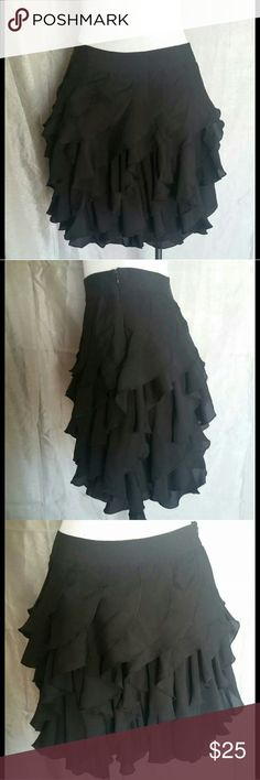 ☆NEW LISTING ☆NWT Kardashian kollection skirt Size small. Color black. Has cascade ruffles very cute. NWT. Wear it with any kind of dressy shoe. Nice for a night out or party. Kardashian Kollection Skirts