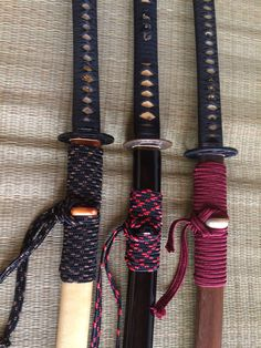 Left to right : L6 katana, Tamahagane and T10 clay tempered in full wrapp sageo.