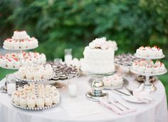 Put the cupcakes and the cake together - and voila! A perfectly pretty wedding dessert table.