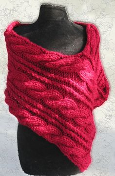 This wrap is knit in bulky yarn on large needles, so it works up fast.  The cable pattern only has a repeat of 8 rows so it's easy ...