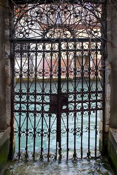 Rita Crane Photography: Venice, Italy -- Garden Gate, San Giorgio dei Greci, Venice, via Flickr.  --  the garden gate entrance to the beautiful church San Giorgio dei Grecie, in the Castello district of Venice. One glides into the docking place & steps onto marble stairs to get to the garden courtyard. Tall boots needed to navigate these kinds of entrances during aqua alta....high water