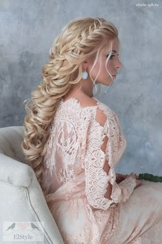 french braided long bridal hairstyle with vintage long sleeves wedding dress / http://www.deerpearlflowers.com/new-wedding-hairstyles-to-try/