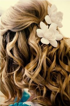 Loose curls and flowers. So pretty.