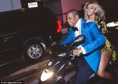 Fit for a queen: Beyonce and Jay Z roared up to Diddy's CIROC The New Year party in Miami on a scooter