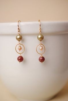 These simple dangle earrings for women feature a cluster of garnet on gold-filled components. Gold-filled earwire. Gold-filled earwire and wirework (lead- and nickel-free) Garnet focal, gemstones Each