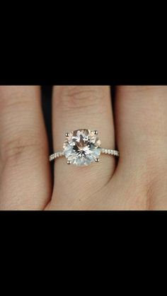 Rose gold (or regular (non-yellowy)) gold) solitaire engagement ring with diamonds on the band