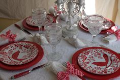 Lovely red tablesetting ~ looks like a matelasse bedspread used as a table cover ~ Pier One bird plates `