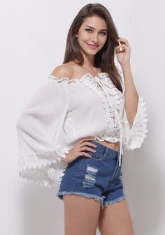 This bohemian lace crop top is cut in delicate floral lace hem with long bell sleeves, an off shoulder neckline and straps at the front. | Lookbook Store
