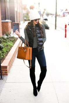 Striped top + black puffer vest + skinny jeans + beanie + over the knee boots